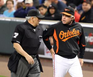 Umpire Larry Vanover (27) and Baltimore Orioles manager Buck Showalter (26)